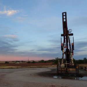 Oil well at sunrise