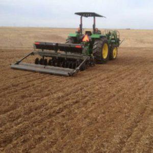 Tractor Gradding Land